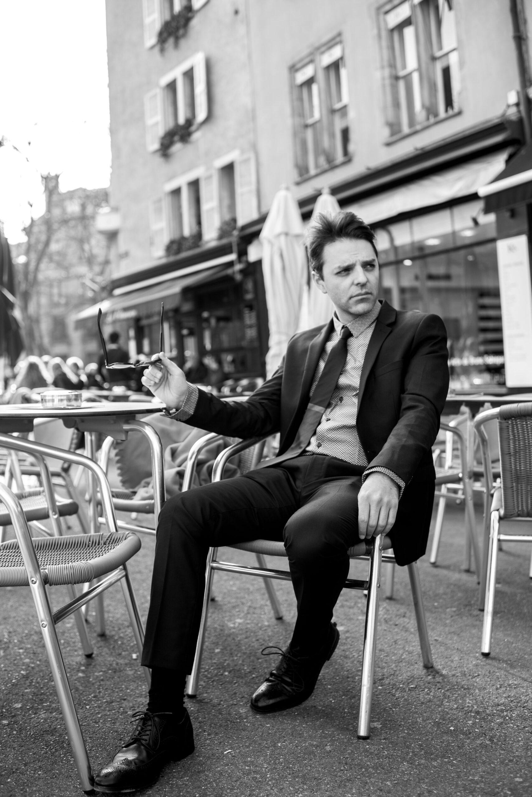 Andrew Joslyn outside cafe